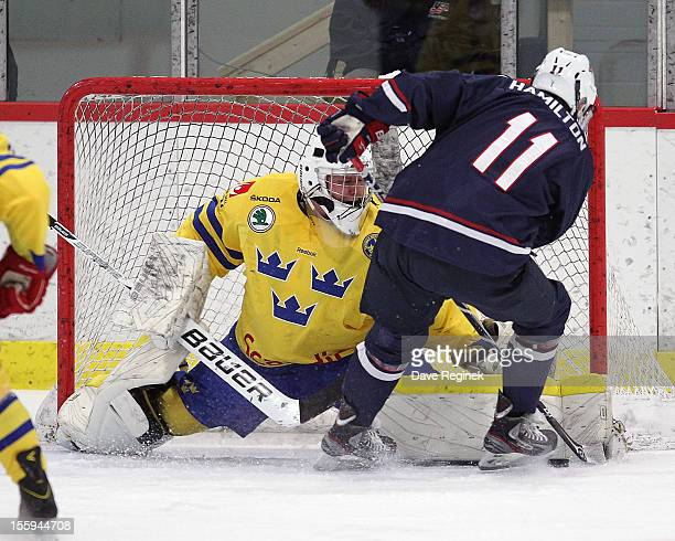 Trevor Hamilton of the USA is stopped on a breakaway by goaltender Ebbe Sionas of Sweden during the U-18 Four Nations Cup on November 9, 2012 at the...
