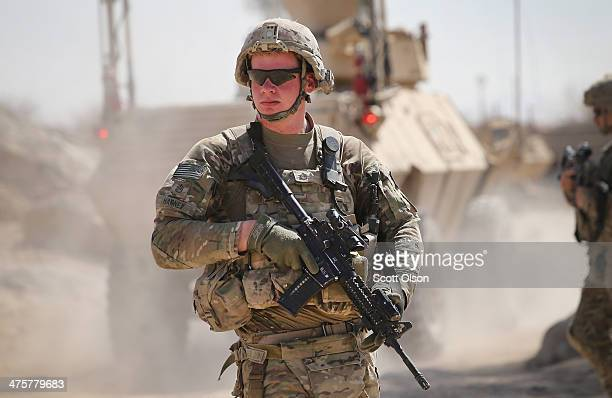 Trevor Harney from Continenta Ohio with the US Army's 4th squadron 2d Cavalry Regiment walks down the street of a village during a joint patrol with...
