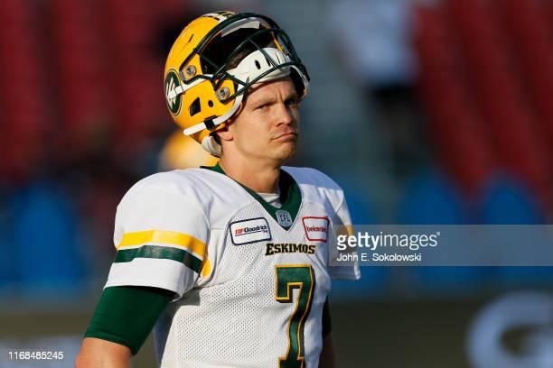 Trevor Harris of the Edmonton Eskimos gestures during warm ups prior a game against the Toronto Argonauts at BMO Field on August 16, 2019 in Toronto,...