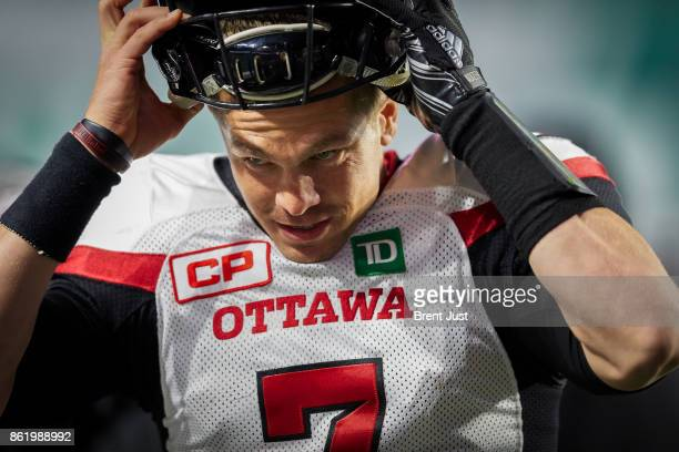 Trevor Harris of the Ottawa Redblacks puts his helmet on in preparation to return to the field during the game between the Ottawa Redblacks and...