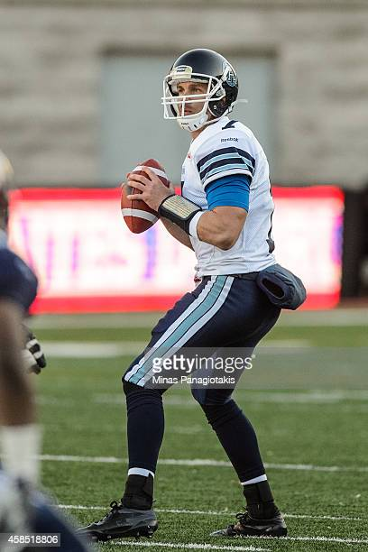Trevor Harris of the Toronto Argonauts looks to throw the ball during the CFL game against the Montreal Alouettes at Percival Molson Stadium on...
