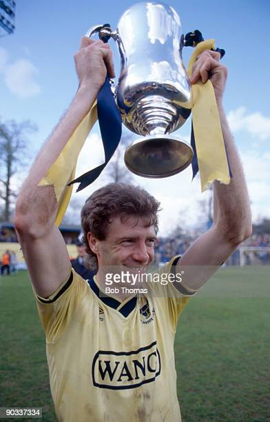 Trevor Hebberd of Oxford United holds aloft the Milk Cup trophy before the Oxford United v Arsenal Division 1 match held at the Manor ground on the...