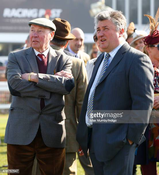 Trevor Hemmings and Paul Nicholls watch the racing as they attend Day 4 of the Cheltenham Festival at Cheltenham Racecourse on March 14 2014 in...