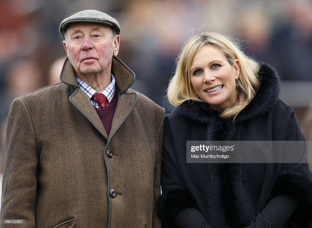 Trevor Hemmings and Zara Phillips watch the Paddy Power Gold Cup Steeple Chase at Cheltenham Racecourse on November 16, 2013 in Cheltenham, England.