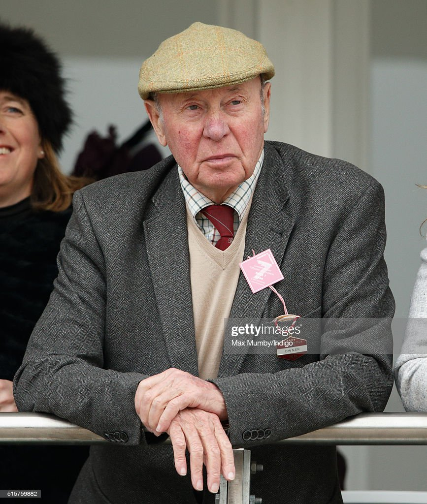 Trevor Hemmings watches the racing as they attend day 1 of the Cheltenham Festival on March 15, 2016 in Cheltenham, England.