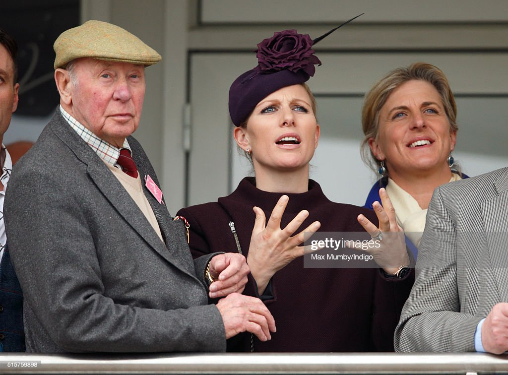 Trevor Hemmings, Zara Phillips and Tina Cook watch the racing as they attend day 1 of the Cheltenham Festival on March 15, 2016 in Cheltenham, England.