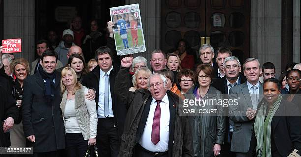 Trevor Hicks and other members of the Hillsborough Support Group and supporters pose on the steps of the High Court in central London on December 19...