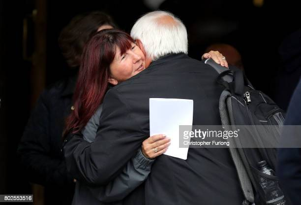 Trevor Hicks hugs a family member after the families of the 96 Hillsborough victims were told the decision that the Crown Prosecution Service will...