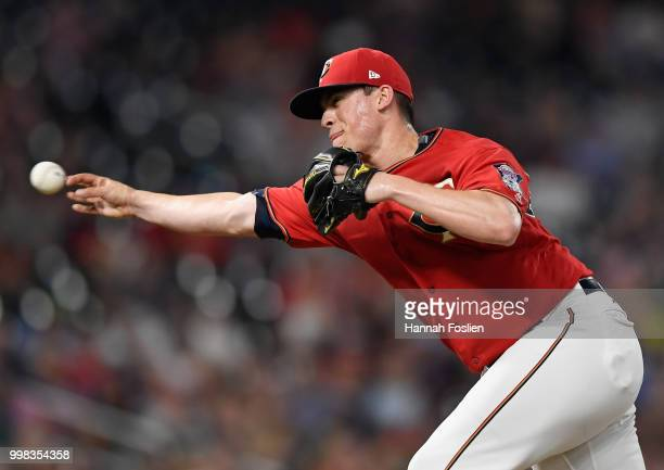Trevor Hildenberger of the Minnesota Twins delivers a pitch against the Tampa Bay Rays during the eighth inning of the game on July 13 2018 at Target...