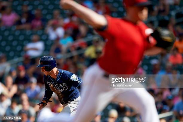Trevor Hildenberger of the Minnesota Twins delivers a pitch as Daniel Robertson of the Tampa Bay Rays steals second base during the game on July 15...
