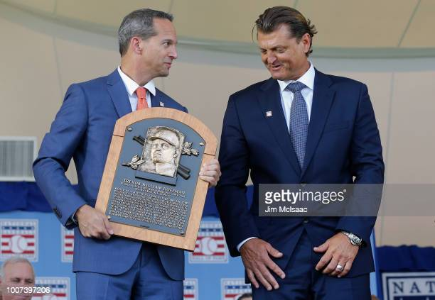 Trevor Hoffman is presented his plaque from Hall of Fame President Jeff Idelson at Clark Sports Center during the Baseball Hall of Fame induction...