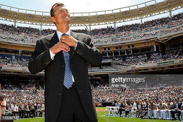 Trevor Hoffman of the San Diego Padres enjoys a scoreboard video during the ceremony for the retirement of Hoffman's prior to the game against the...