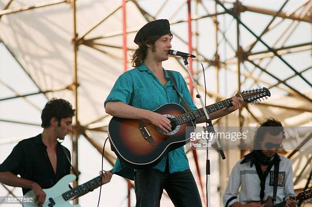 Trevor Hutchinson Mike Scott and Anthony Thistlethwaite of The Waterboys perform on stage at Milton Keynes Bowl on June 21st 1986 in Milton Keynes...