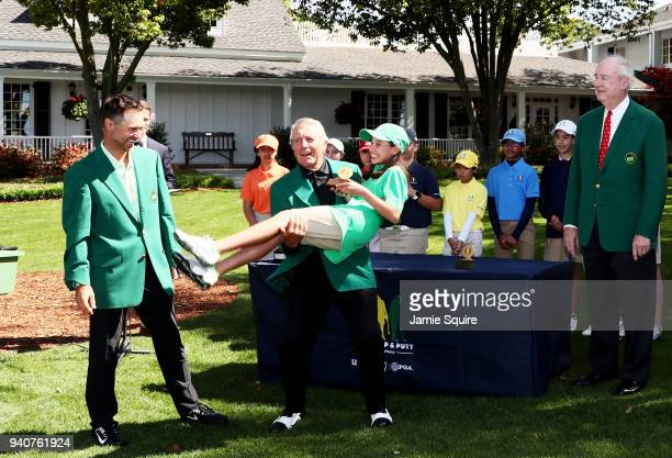Trevor Immelman and Gary Player present Vanessa Borovilos, participant in the girls 10-11, with her trophy during the Drive, Chip and Putt...