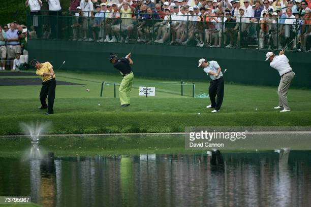 Trevor Immelman, Gary Player, Tim Clarke and Ernie Els of South Africa hit their balls to skip off the water on the 16th hole during the second...