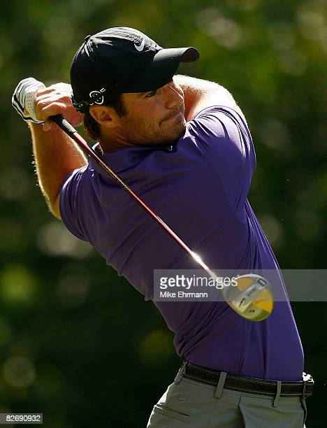 Trevor Immelman hits his tee shot on the ninth hole during the weatherdelayed second round of the BMW Championship on September 6 2008 at Bellerive...