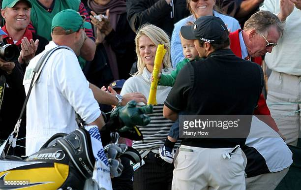 Trevor Immelman of South Africa celebrates his threestroke victory with his wife Carminita son Jacob and caddie Neil Wallace after winning the 2008...
