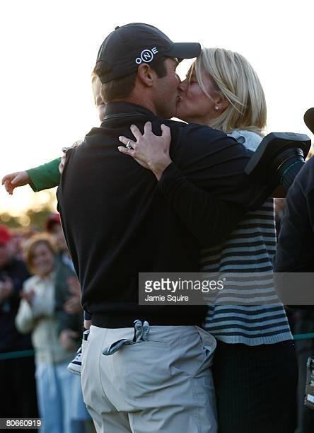 Trevor Immelman of South Africa celebrates his threestroke victory with his wife Carminita and son Jacob after winning the 2008 Masters Tournament at...
