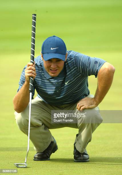 Trevor Immelman of South Africa lines up a putt on the 14th hole during the second round of the Deutsche Bank SAP Open at St. Leon-Rot Golf Club on...