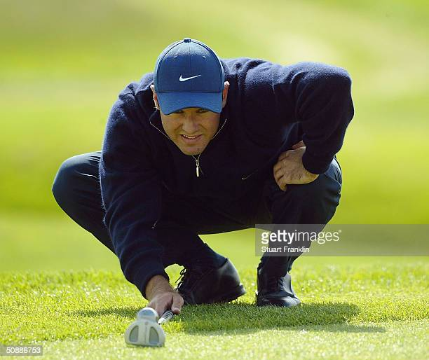 Trevor Immelman of South Africa lines up his putt on the 18th hole during the third round of the Deutsche Bank SAP Open at St LeonRot Golf Club on...