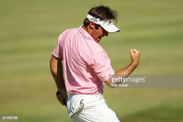 Trevor Immelman of South Africa reacts after making birdie on the 18th hole during the final round of the Stanford St. Jude Championship at TPC...