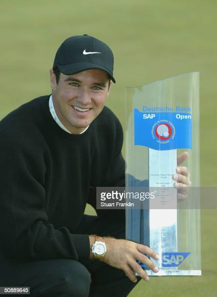 Trevor Immelman of South Africa with the trophy for winning The Deutsche Bank SAP Open at St Leon-Rot Golf Club on May 23, 2004 in Heidelberg,...