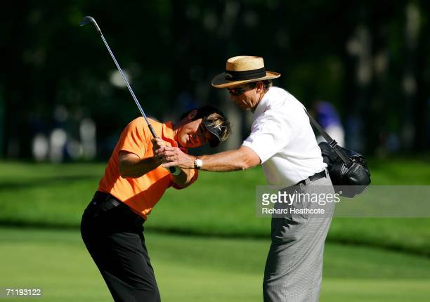 Trevor Immelman of South Africa works with coach David Leadbetter during the Tuesday practice round for the 2006 US Open Championship at Winged Foot...
