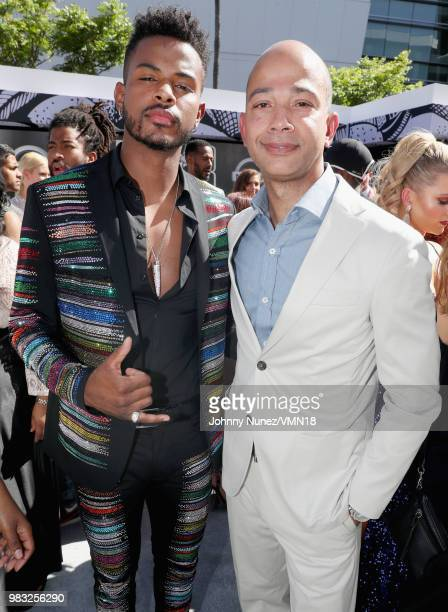 Trevor Jackson and BET Networks' President Scott M Mills attend the 2018 BET Awards at Microsoft Theater on June 24 2018 in Los Angeles California