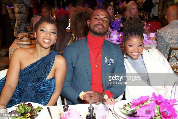 Trevor Jackson with Chloe Bailey and Halle Bailey of Chloe x Halle attend the 2019 Essence Black Women in Hollywood Awards Luncheon at Regent Beverly...
