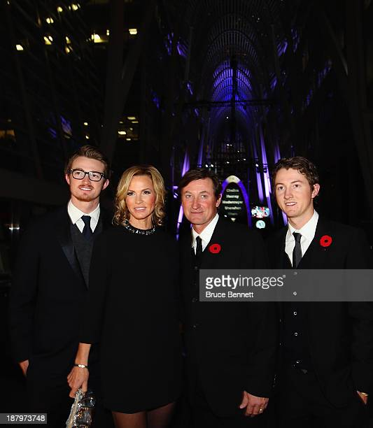 Trevor Janet Wayne and Ty Gretzky walk the red carpet prior to the 2013 Hockey Hall of Fame induction ceremony on November 11 2013 in Toronto Canada