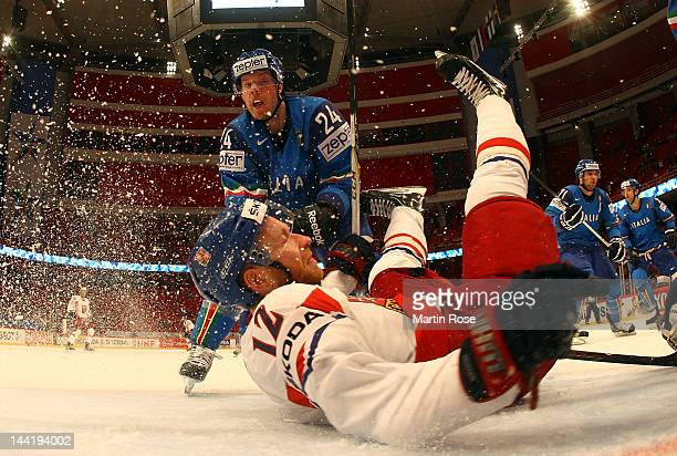 Trevor Johnson of Italy checks Jiri Novotny of Czech Republic in front of the net during the IIHF World Championship group S match between Italy and...
