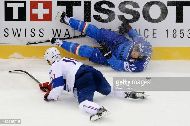 Trevor Johnson of Italy crash with Laurent Meunier of France during the 2014 IIHF World Championship between Italy and France at Chizhovka arena on...