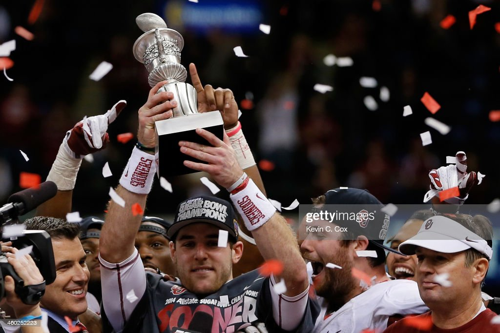 Trevor Knight #9 of the Oklahoma Sooners holds up the MVP trophy after defeating the Alabama Crimson Tide 45-31 during the Allstate Sugar Bowl at the Mercedes-Benz Superdome on January 2, 2014 in New Orleans, Louisiana.