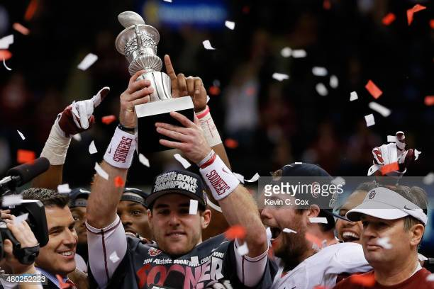 Trevor Knight of the Oklahoma Sooners holds up the MVP trophy after defeating the Alabama Crimson Tide 4531 during the Allstate Sugar Bowl at the...