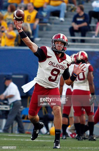 Trevor Knight of the Oklahoma Sooners warms up before the game against the West Virginia Mountaineers on September 20 2014 at Mountaineer Field in...