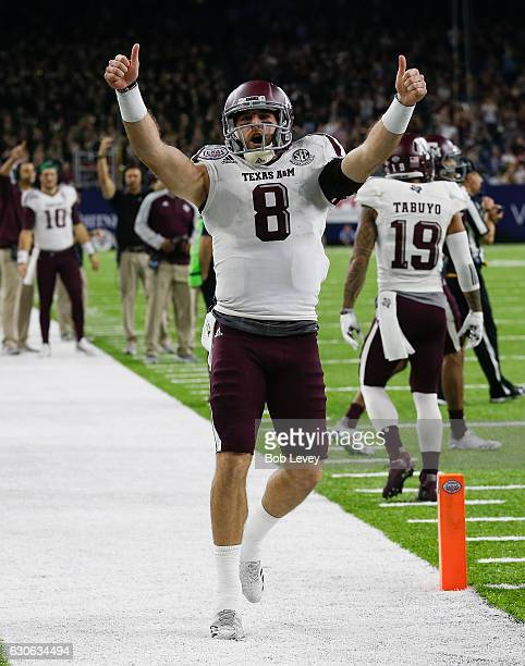 Trevor Knight of the Texas AM Aggies celebrates after throwing a touchdown pass to Josh Reynolds in the fourth quarter Kansas State Wildcats during...