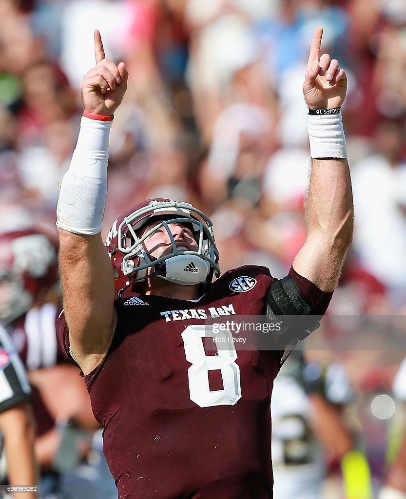 Trevor Knight #8 of the Texas A&M Aggies celebrates his one yard run for a score in the third quarter against the UCLA Bruins at Kyle Field on September 3, 2016 in College Station, Texas. Texas A&M won 31-24 in overtime.