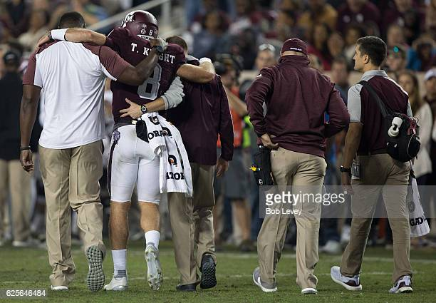 Trevor Knight of the Texas AM Aggies is helped off the field by training staff after an apparent knee injury in the fourth quarter against the LSU...