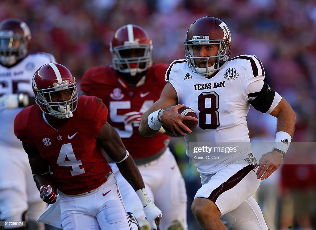 Trevor Knight #8 of the Texas A&M Aggies rushes against Eddie Jackson #4 of the Alabama Crimson Tide at Bryant-Denny Stadium on October 22, 2016 in Tuscaloosa, Alabama.