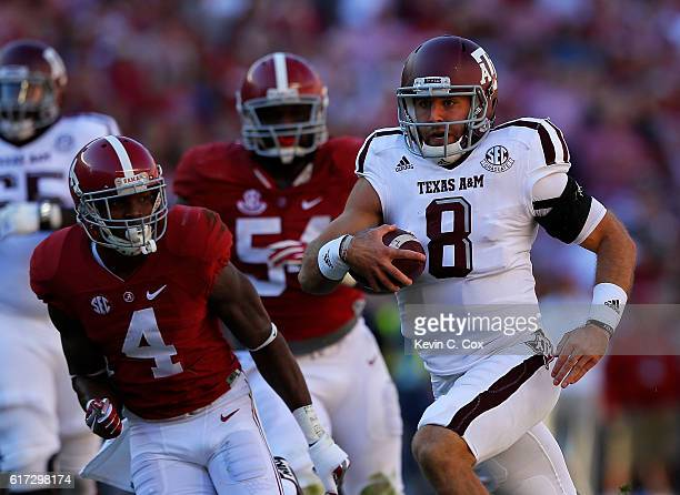 Trevor Knight of the Texas AM Aggies rushes against Eddie Jackson of the Alabama Crimson Tide at BryantDenny Stadium on October 22 2016 in Tuscaloosa...