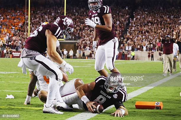 Trevor Knight of the Texas AM Aggies scores a touchdown in the second overtime of their game against the Tennessee Volunteers at Kyle Field on...