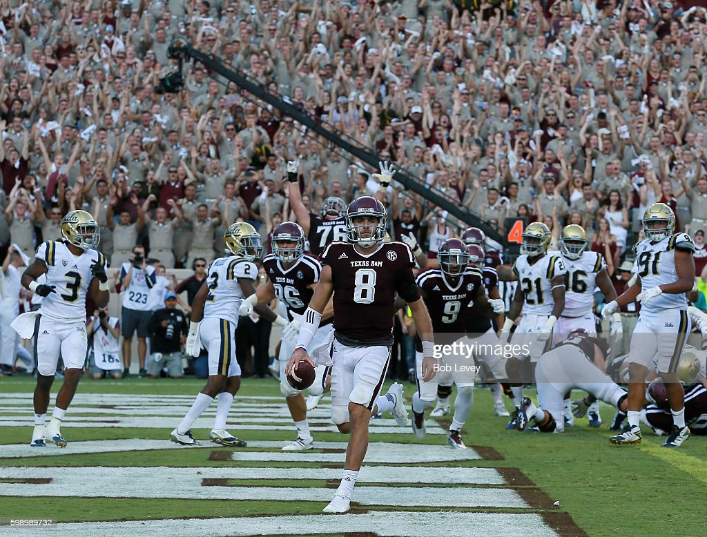 Trevor Knight #8 of the Texas A&M Aggies scores on a 1 yard run in overtime against the UCLA Bruins at Kyle Field on September 3, 2016 in College Station, Texas.