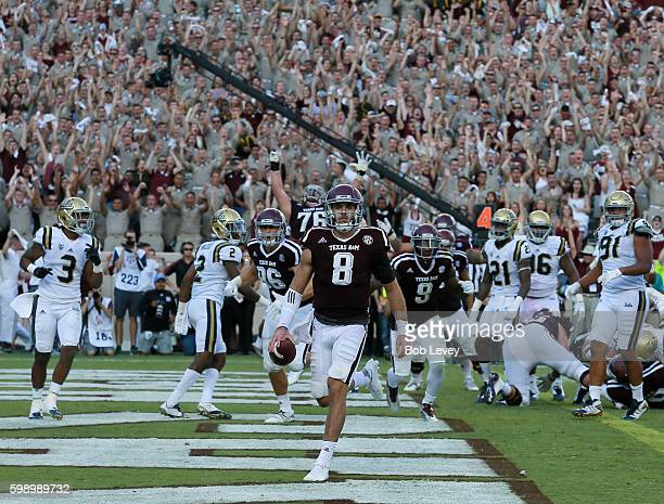 Trevor Knight of the Texas A&M Aggies scores on a 1 yard run in overtime against the UCLA Bruins at Kyle Field on September 3, 2016 in College...