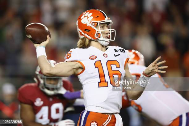 Trevor Lawrence of the Clemson Tigers attempts a pass during the first quarter against the Alabama Crimson Tide in the CFP National Championship...