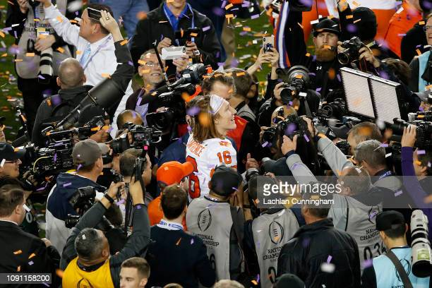 Trevor Lawrence of the Clemson Tigers celebrates after defeating the against the Alabama Crimson Tide in the College Football Playoff National...