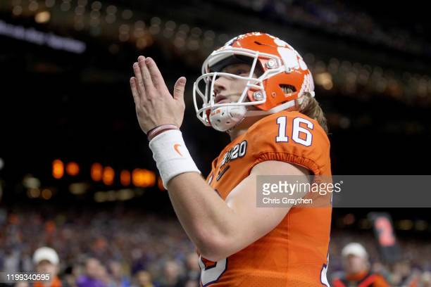 Trevor Lawrence of the Clemson Tigers celebrates after scoring a touchdown against the LSU Tigers in the College Football Playoff National...