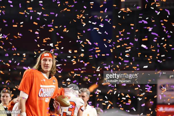Trevor Lawrence of the Clemson Tigers celebrates his teams 29-23 win over the Ohio State Buckeyes in the College Football Playoff Semifinal at the...