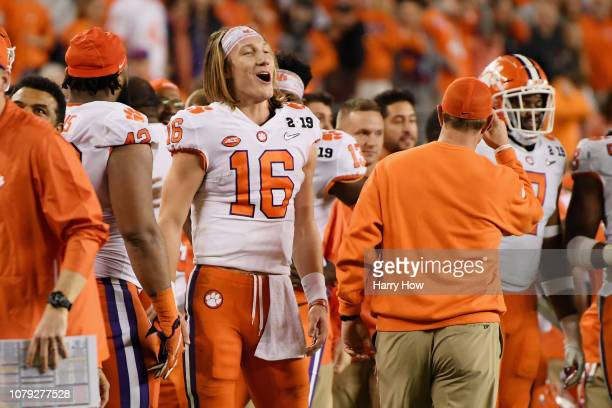 Trevor Lawrence of the Clemson Tigers celebrates with his team late in the game against the Alabama Crimson Tide in the CFP National Championship...