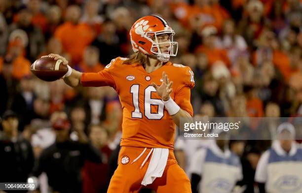 Trevor Lawrence of the Clemson Tigers drops back to pass against the South Carolina Gamecocks during their game at Clemson Memorial Stadium on...