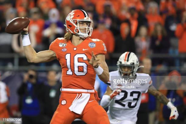 Trevor Lawrence of the Clemson Tigers drops back to pass against the Virginia Cavaliers during the ACC Football Championship game at Bank of America...